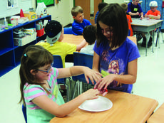 """<div class=""""source""""></div><div class=""""image-desc"""">Mariska Milliken and Katelyn Kelly use their senses to explore in one of last year's modules.</div><div class=""""buy-pic""""><a href=""""/photo_select/35816"""">Buy this photo</a></div>"""