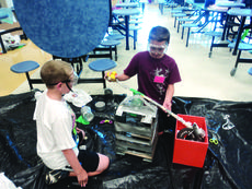"""<div class=""""source""""></div><div class=""""image-desc"""">Two campers from the 2013 camp experience create their own invention.</div><div class=""""buy-pic""""><a href=""""http://web2.lcni5.com/cgi-bin/c2newbuyphoto.cgi?pub=029&orig=camp_invention_2_150.jpg"""" target=""""_new"""">Buy this photo</a></div>"""