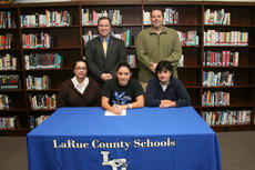 """<div class=""""source"""">Terry Sandidge</div><div class=""""image-desc"""">Christian Cox signed a letter of intent to play softball at Murray State University. Front from left is Christian's mother, Joy Cox, Cox, Lady Hawk coach Mielle DiStefano. In back is LCHS principal Paul Mullins and athletic director David Dawson.</div><div class=""""buy-pic""""><a href=""""/photo_select/385"""">Buy this photo</a></div>"""