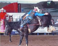 "<div class=""source""></div><div class=""image-desc"">Cody Stephens, defending state high school rodeo champ, is shown in action aboard a bareback bronco.</div><div class=""buy-pic""><a href=""/photo_select/5423"">Buy this photo</a></div>"