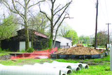 """<div class=""""source"""">Rebecca Roscoe</div><div class=""""image-desc"""">A contractor continues work on a storm water drainage improvement project in Hodgenville.</div><div class=""""buy-pic""""><a href=""""http://web2.lcni5.com/cgi-bin/c2newbuyphoto.cgi?pub=029&orig=construction1.jpg"""" target=""""_new"""">Buy this photo</a></div>"""