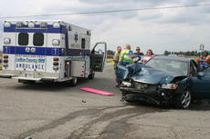 """<div class=""""source"""">Photo by Rebecca Roscoe</div><div class=""""image-desc"""">Five people were transported by ambulance to Hardin Memorial Hospital Friday after a two-vehicle crash at the intersection of Lincoln Parkway and Tonieville Road.</div><div class=""""buy-pic""""><a href=""""/photo_select/30588"""">Buy this photo</a></div>"""