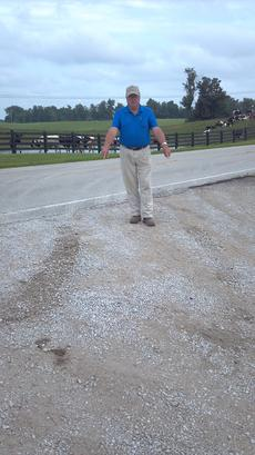 """<div class=""""source""""></div><div class=""""image-desc"""">Donald McDowell stands beside an area where he said a city officer's cruiser threw gravel in his driveway.</div><div class=""""buy-pic""""></div>"""