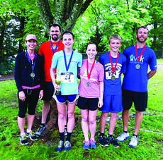 "<div class=""source"">Submitted photo</div><div class=""image-desc"">Several LaRue Countians participated in the ""I Am A Dam Runner"" 5K May 11 at Green River Lake. From left, Kim Childers, 23:48, first in women's 45-49 age group; Scott Sandidge, 22:53, first in men's 40-44 age group; Kristina Durbin, 21:37, first overall in women's division and in women's 15-19 age group; Kaelin Herrin, 25:52, second in women's 15-19 age group; Jacob Cecil, 20:39, second in men's 14 and under age group; and Jim B. Phelps, 19:47, second in men's 30-34 age group. </div><div class=""buy-pic""><a href=""/photo_select/27671"">Buy this photo</a></div>"