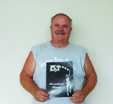 """<div class=""""source"""">Photo by Linda Ireland</div><div class=""""image-desc"""">David Howell shows off a copy of """"Hometown Heroes"""" that has information about the Hodgenville Eagles' play at the state basketball tournament.</div><div class=""""buy-pic""""><a href=""""http://web2.lcni5.com/cgi-bin/c2newbuyphoto.cgi?pub=029&orig=david%2Bhowell.jpg"""" target=""""_new"""">Buy this photo</a></div>"""