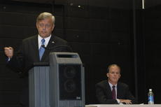 """<div class=""""source"""">Ben Sheroan</div><div class=""""image-desc"""">During Monday's political forum in Elizabethtown, David Boswell of Owensboro responds to a question while Brett Guthrie awaits his opportunity. The state senators are candidates for the 2nd Congressional District seat in the U.S. House of Representatives.</div><div class=""""buy-pic""""><a href=""""/photo_select/11843"""">Buy this photo</a></div>"""