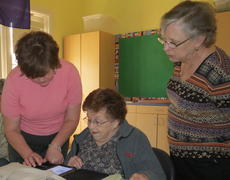 "<div class=""source"">Ron Benningfield</div><div class=""image-desc"">Dana Jolly, left, and Judy Greenwell assist Jean Perkins as she learns more about downloading e-books onto her Nook Color tablet/reader.</div><div class=""buy-pic""><a href=""http://web2.lcni5.com/cgi-bin/c2newbuyphoto.cgi?pub=029&orig=downloading_e-books.jpg"" target=""_new"">Buy this photo</a></div>"