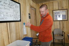 """<div class=""""source"""">Linda Ireland</div><div class=""""image-desc"""">Scott Curtsinger, environmental supervisor for Hardin and LaRue Counties, checks a bottle of cleaning solution for a label. </div><div class=""""buy-pic""""><a href=""""/photo_select/33836"""">Buy this photo</a></div>"""