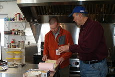 """<div class=""""source"""">Linda Ireland</div><div class=""""image-desc"""">Scott Curtsinger, environmental supervisor for Hardin and LaRue Counties, speaks with restaurant owner Reed Smith during a regular food inspection.</div><div class=""""buy-pic""""><a href=""""/photo_select/33838"""">Buy this photo</a></div>"""
