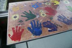 """<div class=""""source"""">Linda Ireland</div><div class=""""image-desc"""">A table covered with the handprints of adult daycare clients was sold.</div><div class=""""buy-pic""""><a href=""""/photo_select/31826"""">Buy this photo</a></div>"""