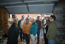 """<div class=""""source""""></div><div class=""""image-desc"""">Bidders looked inside a block garage behind the nursing home.</div><div class=""""buy-pic""""><a href=""""/photo_select/31827"""">Buy this photo</a></div>"""
