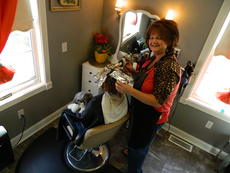 """<div class=""""source"""">Vanessa Hurst</div><div class=""""image-desc"""">Pictured are salon greeter, Jax, sitting in the lap of a client who wishes to remain anonymous, and salon owner Angie Thomas.</div><div class=""""buy-pic""""><a href=""""/photo_select/45175"""">Buy this photo</a></div>"""