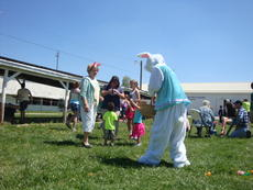 """<div class=""""source""""></div><div class=""""image-desc"""">Children enjoyed visiting with the Easter Bunny during the community egg hunt at the fairgrounds.</div><div class=""""buy-pic""""></div>"""
