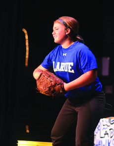 """<div class=""""source"""">KACIE GOODE/The Kentucky Standard</div><div class=""""image-desc"""">Emillee Cundiff performs a monologue about softball for the talent portion of the Distinguished Young Women program Saturday.</div><div class=""""buy-pic""""><a href=""""http://web2.lcni5.com/cgi-bin/c2newbuyphoto.cgi?pub=029&orig=emillee1_0.jpg"""" target=""""_new"""">Buy this photo</a></div>"""