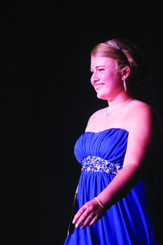 """<div class=""""source"""">KACIE GOODE/The Kentucky Standard</div><div class=""""image-desc"""">Emillee Cundiff is all smiles as she walks across the stage duirng the self-expression portion of the Distinguished Young Women program.</div><div class=""""buy-pic""""><a href=""""http://web2.lcni5.com/cgi-bin/c2newbuyphoto.cgi?pub=029&orig=emillee3_0.jpg"""" target=""""_new"""">Buy this photo</a></div>"""