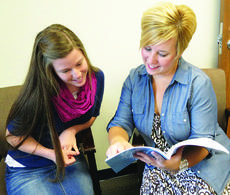 """<div class=""""source"""">Photo by Ron Benningfield</div><div class=""""image-desc"""">Evelyn Whelan, left, National Merit semi-finalist, and Kristi Wright, LaRue County High School guidance counselor, discuss information concerning the PSAT and SAT, assessments that are among the criteria to determine National Merit finalists and resulting college scholarships. </div><div class=""""buy-pic""""><a href=""""/photo_select/30548"""">Buy this photo</a></div>"""