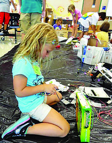 """<div class=""""source""""></div><div class=""""image-desc"""">In this picture taken at last year's Camp Invention, Gabi Sutherland, a third-year returning camper, works on her invention. </div><div class=""""buy-pic""""><a href=""""/photo_select/28832"""">Buy this photo</a></div>"""