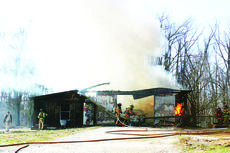 "<div class=""source"">Linda Ireland</div><div class=""image-desc"">A barn and most of its contents were destroyed by fire Saturday afternoon on Carter Brothers Road.</div><div class=""buy-pic""><a href=""http://web2.lcni5.com/cgi-bin/c2newbuyphoto.cgi?pub=029&orig=garage%2Bfire%2B4.jpg"" target=""_new"">Buy this photo</a></div>"