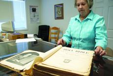 "<div class=""source"">Linda Ireland</div><div class=""image-desc"">Janet Marcum, treasurer for the LaRue County Genealogy Society, displayed an 1894 Bible from the defunct Hodgenville Presbyterian Church that was donated to the society.</div><div class=""buy-pic""><a href=""/photo_select/10522"">Buy this photo</a></div>"