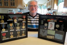 """<div class=""""source"""">Ronnie Benningfield</div><div class=""""image-desc"""">Gordon Bright holds display cases containing several Vietnam War medals he received two weeks before Christmas 2013.</div><div class=""""buy-pic""""><a href=""""/photo_select/33788"""">Buy this photo</a></div>"""