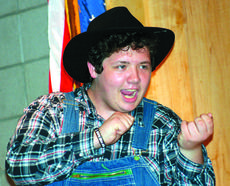 """<div class=""""source"""">Linda Ireland</div><div class=""""image-desc"""">Mac Blair, above, plays several characters. Greater Tuna will be performed 7 p.m. May 21 and 2 p.m. and 7 p.m. May 22 in the LCHS auditorium. </div><div class=""""buy-pic""""><a href=""""http://web2.lcni5.com/cgi-bin/c2newbuyphoto.cgi?pub=029&orig=greater%2Btuna%2Bmac%2Bblair.jpg"""" target=""""_new"""">Buy this photo</a></div>"""