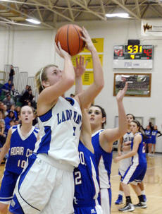 "<div class=""source"">Jill Pickett</div><div class=""image-desc"">LaRue County's Haley Holt gets a shot off past the Adair County defense during Girls' 5th Region Basketball Tournament quarterfinal action Wednesday at Green County High School in Greensburg.</div><div class=""buy-pic""><a href=""/photo_select/26174"">Buy this photo</a></div>"