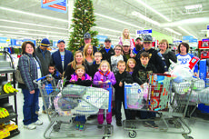 """<div class=""""source"""">Melanie Wells</div><div class=""""image-desc"""">LaRue County children shopped with City of Hodgenville police officers and emergency personnel at Wal-Mart in Campbellsville last year. The """"Hangin' with Heroes"""" program provides clothing, toys and other necessities to needy children during the holiday season. Also pictured are Mayor Kenny DeVore and his wife Angela DeVore.</div><div class=""""buy-pic""""><a href=""""/photo_select/55877"""">Buy this photo</a></div>"""