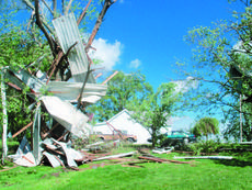 """<div class=""""source""""></div><div class=""""image-desc"""">The home of J.C. and Betty Henderson on Tonieville Road received some damage in Saturday's storm. Remnants of an outbuilding can be seen in the top of a tree. Residents are assessing damage and waiting for rain to stop to continue clean-up.</div><div class=""""buy-pic""""><a href=""""/photo_select/10917"""">Buy this photo</a></div>"""