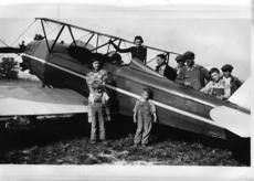 """<div class=""""source"""">Submitted photo</div><div class=""""image-desc"""">In 1935 an airplane landed in Howardstown and gave rides to residents for 50 cents a piece. The pilot, Alfred D. Heath stayed in the area for three days before taking off to continue his travels. Pictured in the photo are: Archie Spalding (cockpit), Estelle Spalding (standing on plane); left to right (back) pilot Alfred D. Heath, DeLime Boone, Soup Boone, Jimmy Boone and Adolph Boone. Those in the front are unknown. </div><div class=""""buy-pic""""><a href=""""/photo_select/29967"""">Buy this photo</a></div>"""