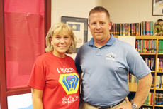 "<div class=""source"">FELICIA MARIE GRAY</div><div class=""image-desc"">Sue Osborne, retiring principal at Hodgenville Elementary School, congratulated Eric Hughes, who was hired Wednesday for the job.</div><div class=""buy-pic""><a href=""/photo_select/35320"">Buy this photo</a></div>"
