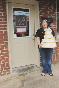 """<div class=""""source"""">Photo by Vanessa Hurst</div><div class=""""image-desc"""">Sarah Anthony in front of her shop on Walter's Avenue. </div><div class=""""buy-pic""""><a href=""""/photo_select/42437"""">Buy this photo</a></div>"""
