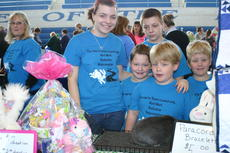 "<div class=""source"">Linda Ireland</div><div class=""image-desc"">Sarah Duvall and the Rock triplets, Devin, Kagan and Gabriel, showed their rabbits at Saturday's Expo.</div><div class=""buy-pic""><a href=""/photo_select/33941"">Buy this photo</a></div>"