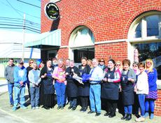 """<div class=""""source"""">Allison Shepherd</div><div class=""""image-desc"""">The Awesome Café official open house and ribbon cutting was held in conjunction with The LaRue County Chamber of Commerce on Friday, March 2, 2018. Attending the event were from the left: Ethan Napier, Josh Singer, Paula Wood, Shannon Minter, Christal Milliner, Amanda Belk, J.T. Napier, Virginia Napier, Tommy Patterson, Owner Marie Riggs, Dana Higgins, Teleana Davis, Johnny Riggs, Chamber President Patty Holbert, Elizabeth Riggs, Iris LaRue, Vivian Dunn, Karen Cochran, Katie McDowell, and Chamber Executive Director Sandy Kidd. </div><div class=""""buy-pic""""><a href=""""/photo_select/58083"""">Buy this photo</a></div>"""