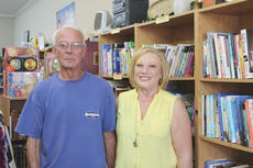 """<div class=""""source"""">Doug Ponder</div><div class=""""image-desc"""">Lincoln's Loft owners David and Becky Harrison opened the bookstore in December 2007. The bookstore carries a wide variety of new and used books including autobiography, children, Christian, cooking, crime, current events, history, romance and many more. </div><div class=""""buy-pic""""><a href=""""/photo_select/43348"""">Buy this photo</a></div>"""