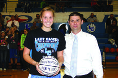 """<div class=""""source"""">Photo by Terry Sandidge</div><div class=""""image-desc"""">Lady Hawk Coach Travis Wootton, right, presented Ivy Brown with a 2,000-point game ball at a recent game.</div><div class=""""buy-pic""""><a href=""""/photo_select/32453"""">Buy this photo</a></div>"""