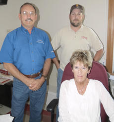 "<div class=""source"">Ron Benningfield</div><div class=""image-desc"">Jim Phelps, left, stands with two of his 10 employees, Service Manager Travis Monin and Office Manager Karen Clements.   </div><div class=""buy-pic""><a href=""/photo_select/43346"">Buy this photo</a></div>"