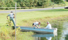 "<div class=""source"">Linda Ireland</div><div class=""image-desc"">Kentucky State Troopers and Coroner Todd Skaggs used a boat to recover a body from a small lake across from LaRue County Middle School Thursday.</div><div class=""buy-pic""><a href=""http://web2.lcni5.com/cgi-bin/c2newbuyphoto.cgi?pub=029&orig=jimmy_martin2_rgb.jpg"" target=""_new"">Buy this photo</a></div>"