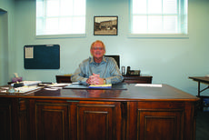 """<div class=""""source"""">Linda Ireland</div><div class=""""image-desc"""">Interim Mayor Kenny DeVore spoke to several reporters Friday from Hodgenville City Hall. He spent Friday attempting to locate ordinances and minute books.</div><div class=""""buy-pic""""><a href=""""http://web2.lcni5.com/cgi-bin/c2newbuyphoto.cgi?pub=029&orig=kenny_devore_at_desk.jpg"""" target=""""_new"""">Buy this photo</a></div>"""