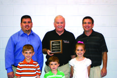"<div class=""source"">Rebecca Roscoe</div><div class=""image-desc"">Alex LaRue accepted the award for Outstanding Business/Professional Person; on behalf of his father, James ""Jim"" LaRue, founder of LaRue Insurance. Alex's sons, Jack, left, and Aaron, accompanied him to accept the award. Grandchildren in front are Jameson LaRue, Clay LaRue and Audrey LaRue.</div><div class=""buy-pic""><a href=""/photo_select/27650"">Buy this photo</a></div>"