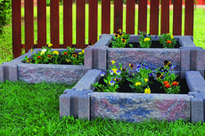 "<div class=""source"">Courtesy of Infinity Lawn and Garden </div><div class=""image-desc"">Incorporating raised flower beds using stone planters can beautify the landscape without taking a lot of time or effort.</div><div class=""buy-pic""></div>"