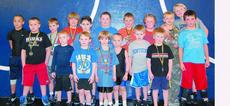 "<div class=""source""></div><div class=""image-desc"">The LaRue County youth wrestlers traveled to St. X High School in Louisville Feb. 28 to compete in the Kentucky Elementary Region 2 Wrestling Tournament. Front from left, Seth Brooks, Bryson Puyear, Tristin Brown, Tharon Blair, Austin Waggoner, Gabe LaFol</div><div class=""buy-pic""><a href=""/photo_select/5149"">Buy this photo</a></div>"