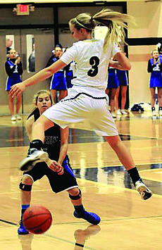 "<div class=""source"">Photo by Neal Cardin</div><div class=""image-desc"">LaRue County's Mallory Williams passes to a teammate under the defense of Elizabethtown's Livie Bowling during Monday night action at Charlie Rawlings Memorial Gymnasium.</div><div class=""buy-pic""><a href=""/photo_select/33002"">Buy this photo</a></div>"