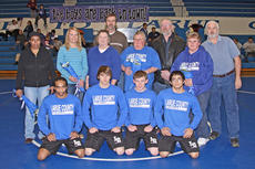 """<div class=""""source"""">Terry Sandidge</div><div class=""""image-desc"""">The Mat Hawk seniors were honored Wednesday at their final home match. From left, Shaquille Cox, Cody Williams, Shelby Floyd and Vince Couch.</div><div class=""""buy-pic""""><a href=""""/photo_select/13119"""">Buy this photo</a></div>"""