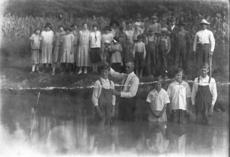 """<div class=""""source"""">Submitted photo</div><div class=""""image-desc"""">Members of Pleasant Grove Baptist Church gathered at a stream for a baptism in 1924. Pictured are Roy Raine, Bro. Cantrell, Ruth Raine, Edna Raine and Walter Raine.</div><div class=""""buy-pic""""><a href=""""/photo_select/30438"""">Buy this photo</a></div>"""