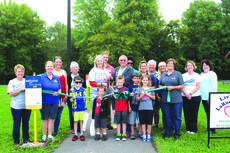 """<div class=""""source"""">Doug Ponder</div><div class=""""image-desc"""">The Livin' Well LaRue coalition held a ribbon cutting for the Born Learning Trail at CreekFront Park in Hodgenville on Thursday, September 14. The event included food, prizes and more.  The trail is a series of ten stations set up along the path of CreekFront Park near the pavilion and playground.</div><div class=""""buy-pic""""><a href=""""/photo_select/55257"""">Buy this photo</a></div>"""