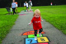 """<div class=""""source"""">Doug Ponder</div><div class=""""image-desc"""">One-year-old Taylor Garrett of Elizabethtown enjoyed the painted designs on the sidewalk at CreekFront Park during the ribbon cutting of the Born Learning Trail on Thursday, September 14. </div><div class=""""buy-pic""""><a href=""""/photo_select/55259"""">Buy this photo</a></div>"""