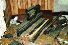 """<div class=""""source"""">Linda Ireland</div><div class=""""image-desc"""">An old player piano is in pieces at the house.</div><div class=""""buy-pic""""><a href=""""/photo_select/27549"""">Buy this photo</a></div>"""
