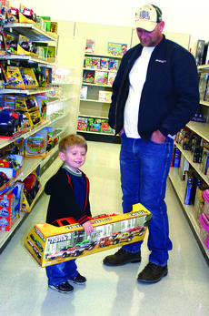 "<div class=""source"">Linda Ireland</div><div class=""image-desc"">Rayden Smith, who celebrated his third birthday on Dec. 20, was the boys' winner for The LaRue County Herald News' Santa Letter drawing. Rayden, the son of Roy Smith and Melanie Brincko, chose a Tonka truck set for his gift.</div><div class=""buy-pic""><a href=""/photo_select/24892"">Buy this photo</a></div>"