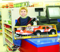 "<div class=""source"">Linda Ireland</div><div class=""image-desc"">Rayden Smith, who celebrated his third birthday on Dec. 20, was the boys' winner for The LaRue County Herald News' Santa Letter drawing. Rayden, the son of Roy Smith and Melanie Brincko, chose a Tonka truck set for his gift.</div><div class=""buy-pic""><a href=""/photo_select/24893"">Buy this photo</a></div>"
