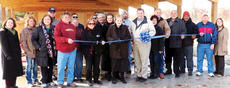 """<div class=""""source"""">Photo by Ron Benningfield</div><div class=""""image-desc"""">Photo by Ron Benningfield LaRue County Fiscal Court held a ribbon-cutting ceremony and reception Nov. 12 for the LaRue County Environmental, Education, and Research Center's pavilion. Members of the Pearman family, who once owned the property, and local magistrates attended. From left, Theresa Howard, Tracy Petkovich, Gloria Farmer, David Harrison, Joe Pearman, Dean Henderson, Nina Cundiff, John and Mary McGuffey, Louise Pearman Bell (holding scissors), Andy Bell, Judge/executive Tommy Turner, Kathy Pearman, Wesley Pearman, Ricky Whitlock, Tony Stewart, Ronald Dale Nunn and Krista Levee.</div><div class=""""buy-pic""""></div>"""